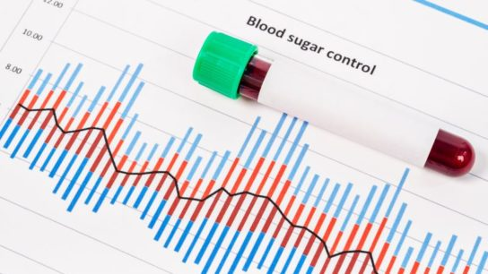 A vial of blood on medical test forms