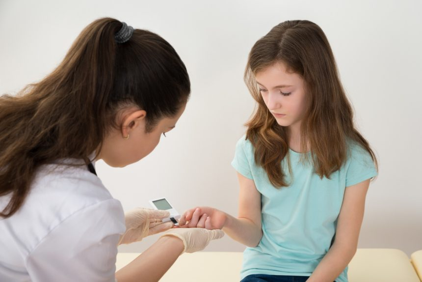 testing young girl's blood sugar levels