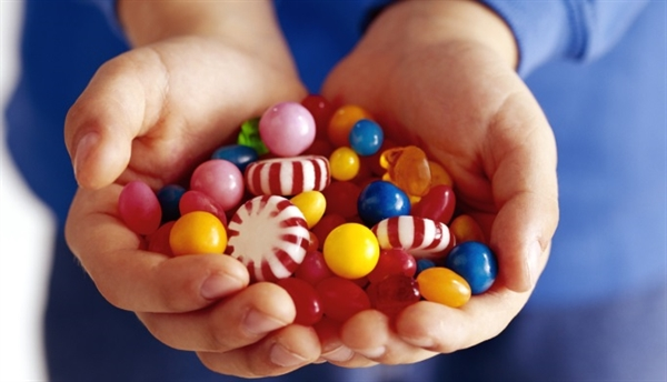 """During Halloween, a little extra candy may be lying around the house. Saving these sweets for later or encouraging children to """"trade them in"""" for prizes or rewards may help them to consume less."""
