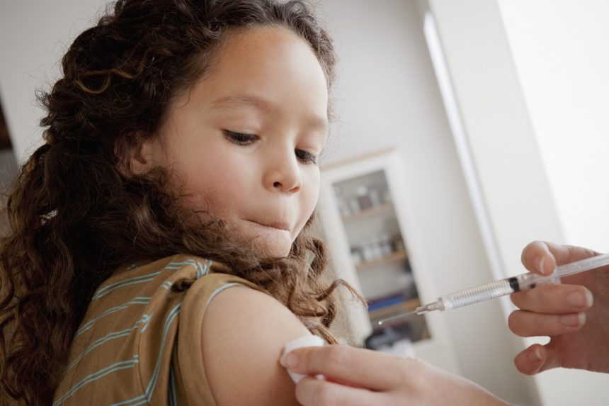 Child receiving the influenza vaccine.
