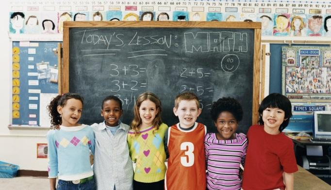 Children standing in classroom