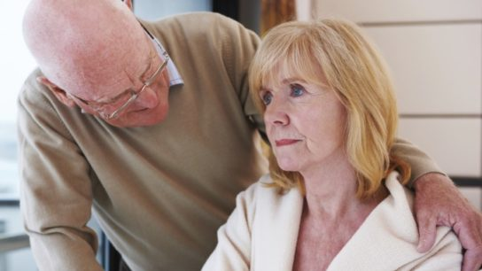Man caring for woman with dementia