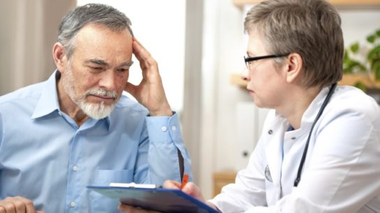 Depressed man with doctor