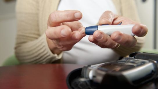 A woman testing her glucose levels