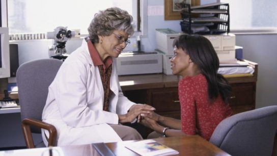 Doctor counseling female patient
