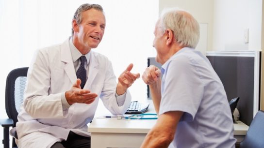Doctor with older male patient
