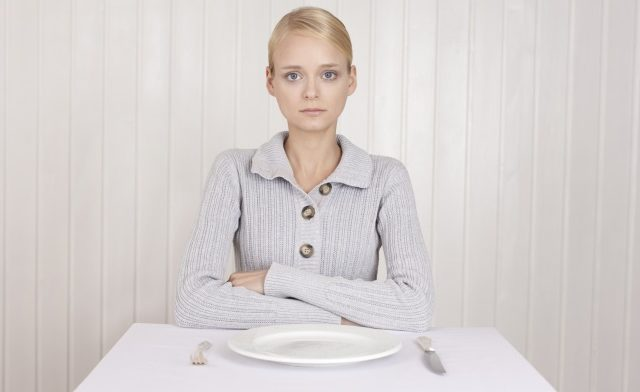 Young woman with eating disorder