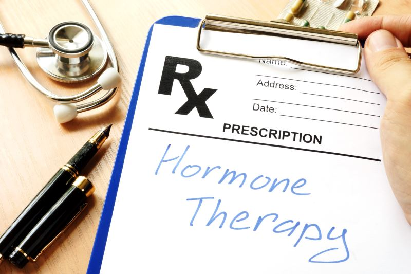 Hormone therapy written on a paper on a clipboard