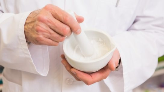 Mixing medicine with a mortar and pestle