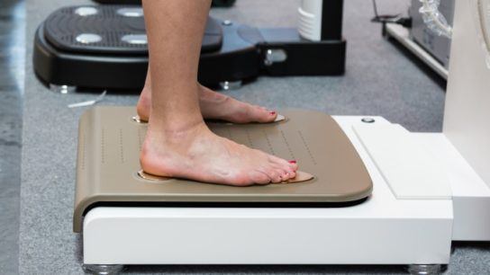 Person being weighed on a scale