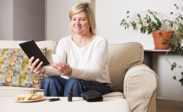 woman checking blood sugar