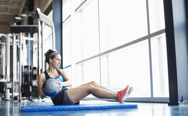 woman in gym exercising abdominals