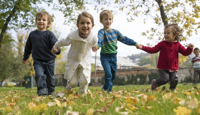 Young children playing outside