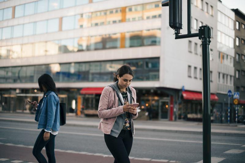 An adolescent girl walking through a city