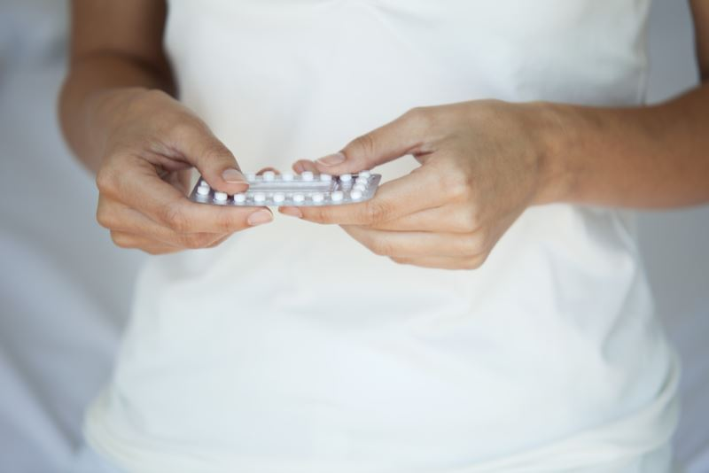A woman holding contraceptive