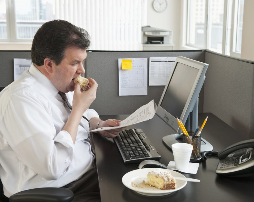 business man eating at desk