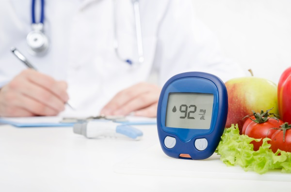 healthy foods next to glucometer