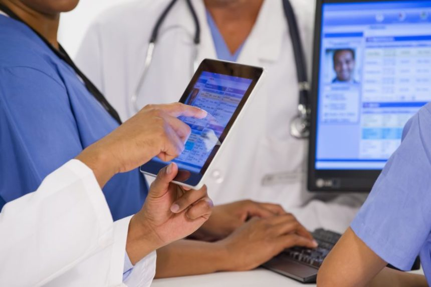 Physicians at a hospital using a tablet