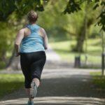 An overweight woman jogging