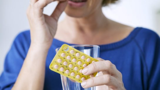 woman taking birth control pill
