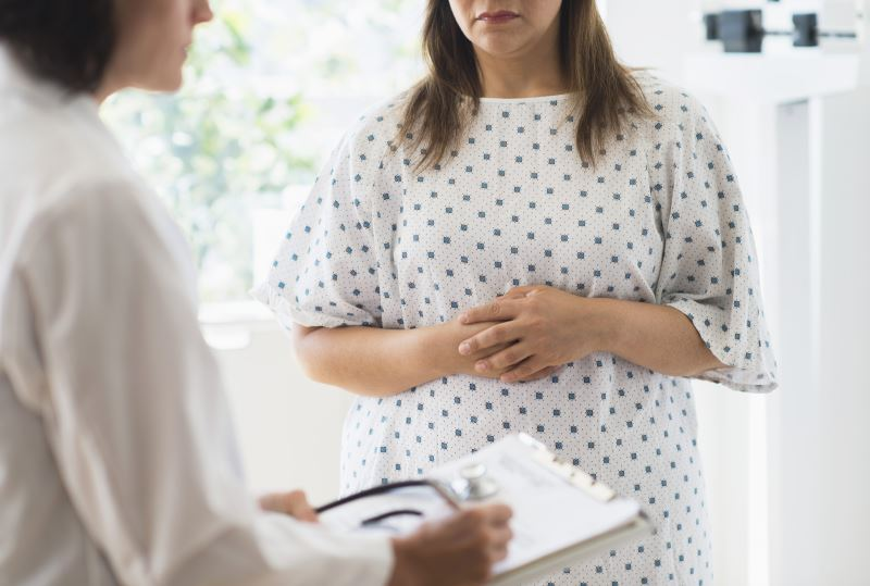 An obese patient speaking with a physician