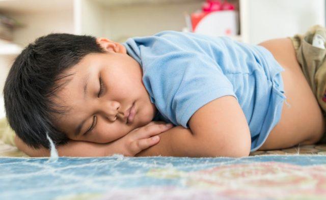 An overweight child sleeping
