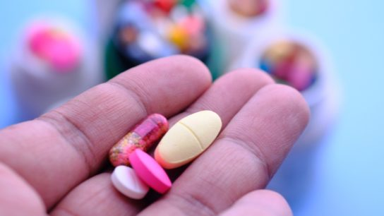 pills or supplements in hand