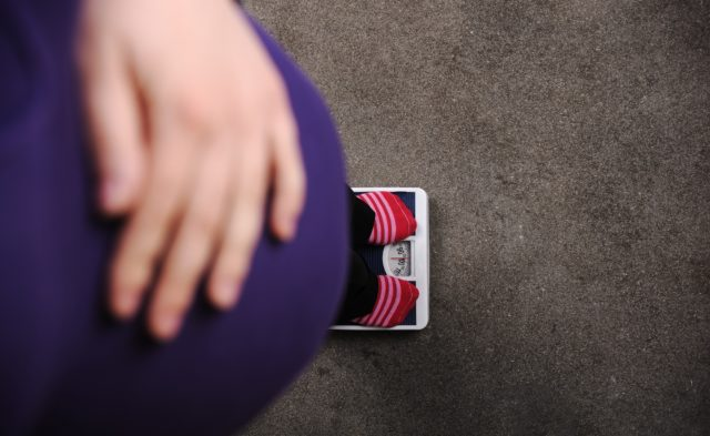 Pregnant woman on scale