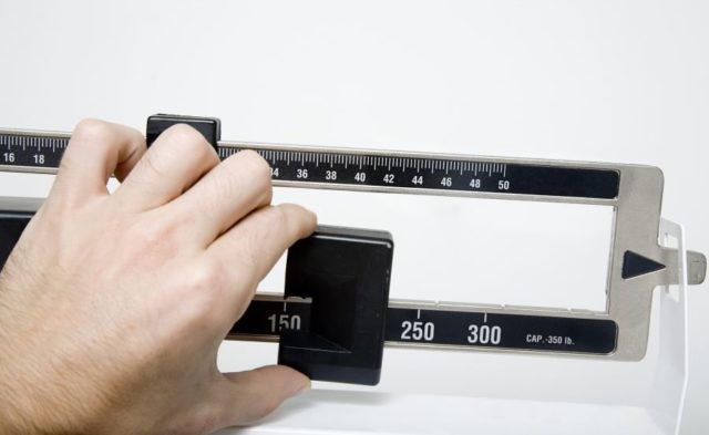 A person being weighed on a scale