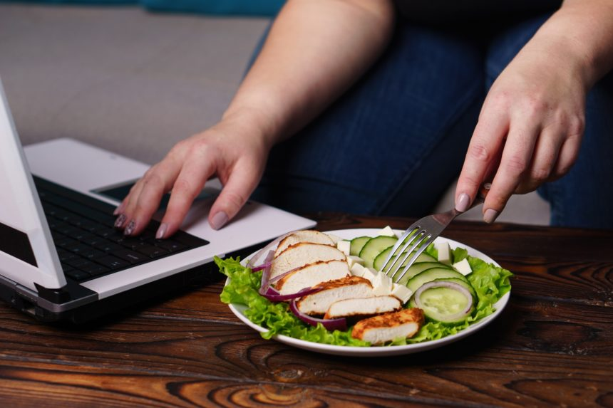Woman eating healthy food during work time