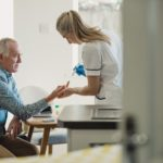 Senior man with diabetes having glucose levels checked