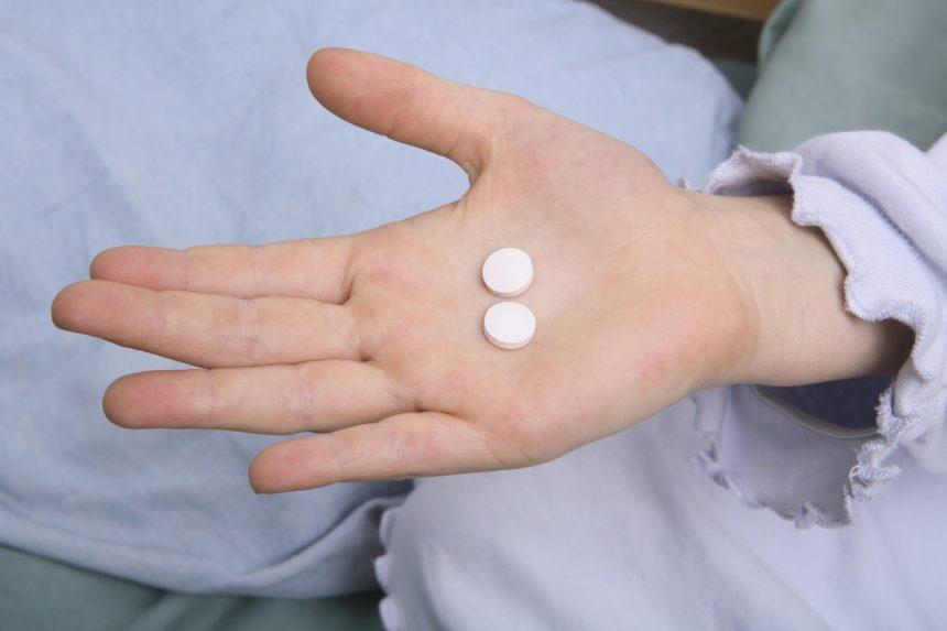 child pills in hand