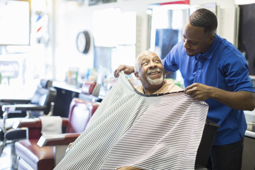 man getting a haircut in barber shop