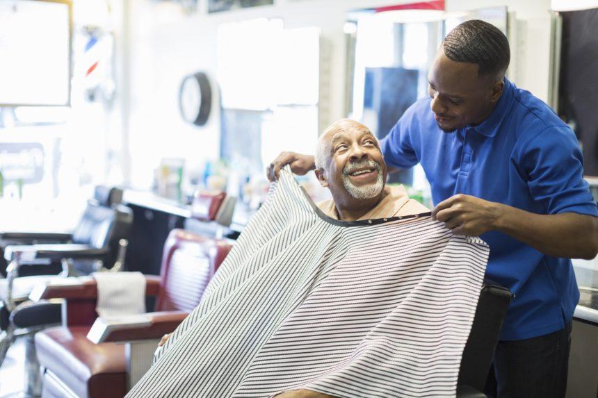 man getting a haircut in barber shop