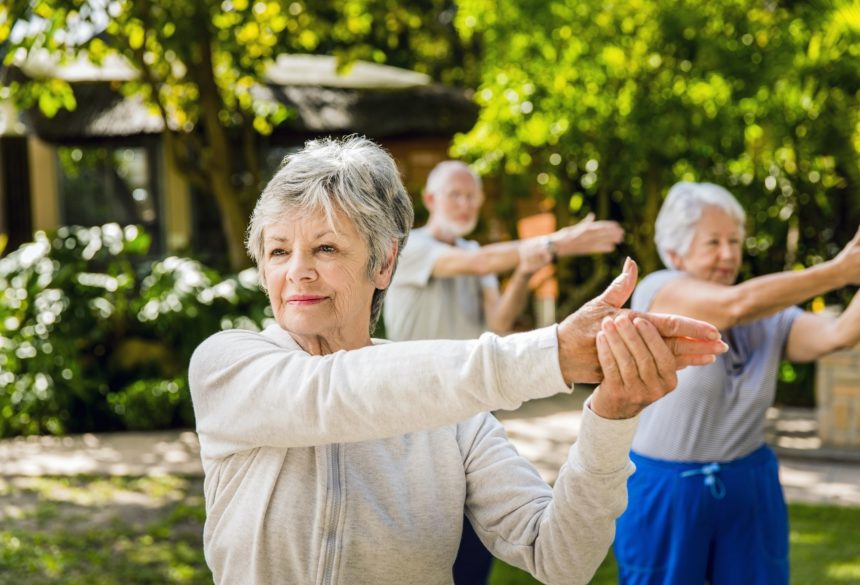 Older group of people exercising outside