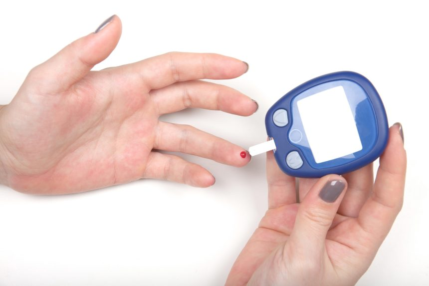 Woman Testing High Blood Sugar With Glucometer