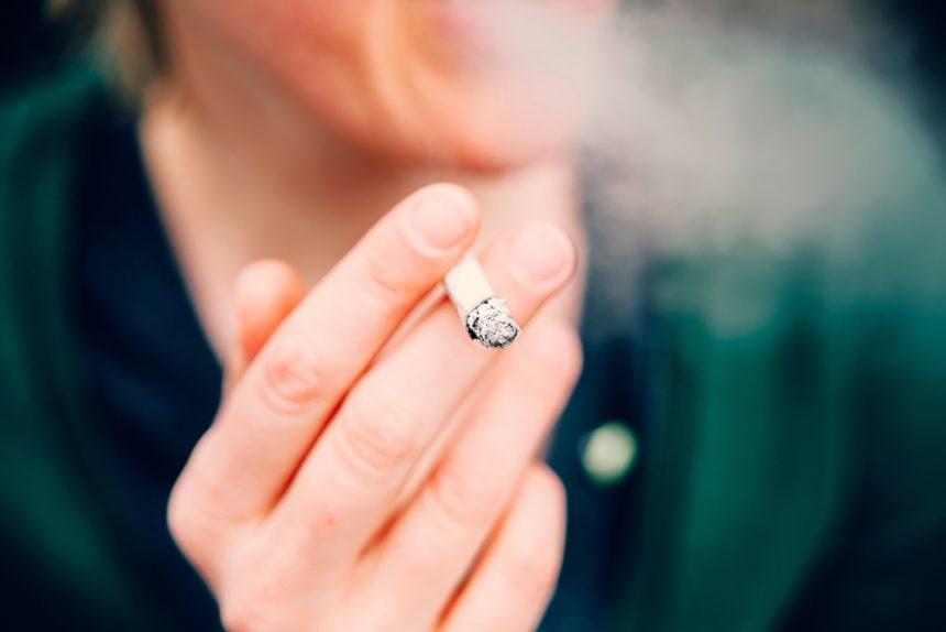 Person smoking a cigarette