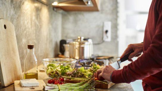 person cutting veggies
