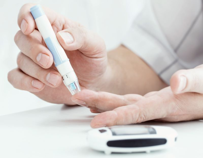 A man with testing blood sugar levels