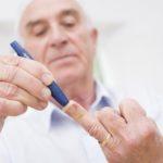 man giving glucose test