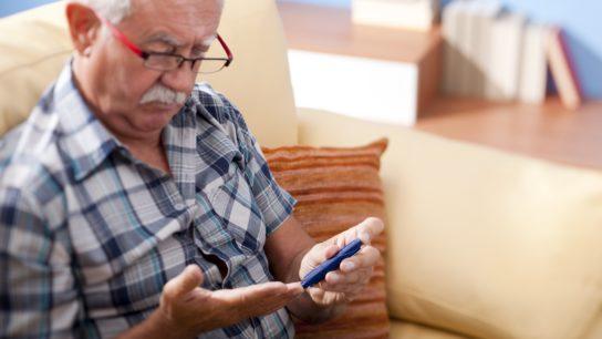 man taking his blood sugar