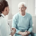 older man speaking with doctor