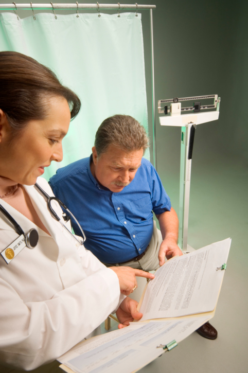 Man talking with doctor about results