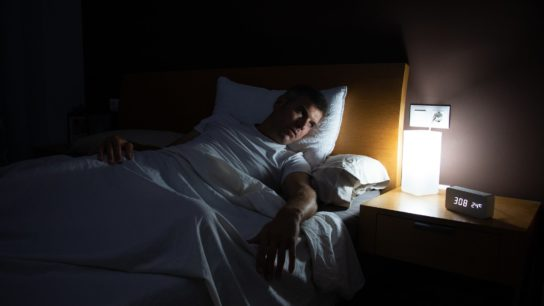 Man with insomnia in the night.