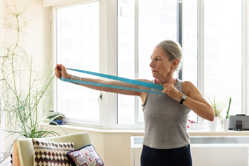 older woman using exercise resistance band