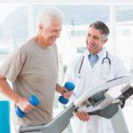 senior white man having exercise assessment in doctor's office
